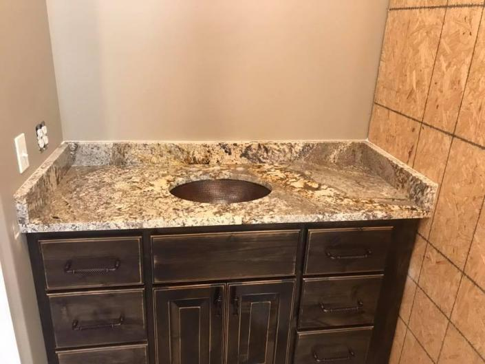 The simple addition of a granite countertop can do wonders for your bathroom!